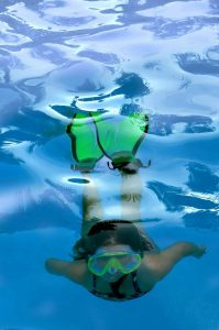 Girl testing her mask and fins